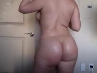 college girl pawg oils her booty and body
